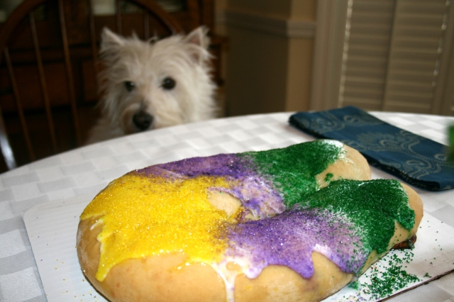 We're awaiting the cutting of the King Cake.